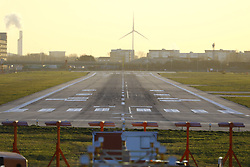 © Licensed to London News Pictures. 12/02/2018. London, UK. The runway lies empty and unused at City Airport after a World War II era bomb was found in The River Thames during routine work on nearby King V Dock. Police have evacuated nearby residents, closed the airport and set up a 214-metre exclusion zone. Photo credit: Peter Macdiarmid/LNP