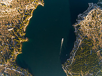 Aerial view of a boat over the waters of Sibenik, Croatia