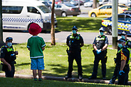 A little boy is seen chatting with police during an Extinction Rebellion protest in Melbourne.  A small group of climate protesters marched from Flagstaff Gardens to The Queen Victoria Market and ending with two individuals gluing themselves together, and then glued themselves to Victoria Avenue outside of the Market. This comes as 5 new COVID-19 cases were uncovered in Melbourne's revamped Hotel Quarantine, breaking almost 40 days of virus free days. (Photo by Dave Hewison/Speed Media)