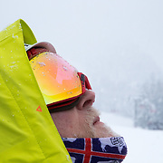 Andrew Whiteford looks to the sky as the snow heavily falls on the Tetons.