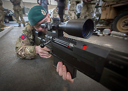 26/03/2014.  Corporal Ryan Purdy (34) form Luton and a member of the Royal Engineers demonstrates an AW50 rifle, designed to destroy improvised explosive devices (IED). The display was part of an effort by the British Army to put on show it's new specialist, combat and command skills formation today. This new part of the Army will be made up of 36000 Regular and Reserve soldiers, which is a third of the army as a whole and supports the logistics of operations both in the UK and abroad.  The command will officially launch on the 1 Apr 14.  Alison Baskerville/LNP