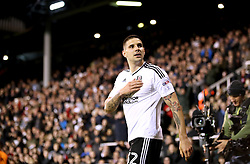 Fulham's Aleksandar Mitrovic taps the badge on his shirt as he celebrates scoring his side's second goal of the game during the Sky Bet Championship match at Craven Cottage, London.