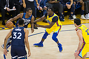 Golden State Warriors forward Draymond Green (23) defends Minnesota Timberwolves forward Andrew Wiggins (22) at Oracle Arena in Oakland, Calif., on January 25, 2018. (Stan Olszewski/Special to S.F. Examiner)