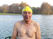 Portrait of Bill Deeley, a member of the Serpentine Swimming Club, Hyde Park, London, UK. The Serpentine Lake is situated in Hyde Park, London's largest central open space. The Serpentine Swimming Club was formed in 1864 'to promote the healthful habit of bathing in open water throughout the year'.  Its headquarters were beneath an old elm tree on the south side of the lake, a wooden bench for clothing being the only facility.  At this time London was undergoing rapid expansion and Hyde Park was now in the centre of a densely populated built up area and provided a place of relaxation to its urbanised masses. Now, the club has its own (somewhat spartan) changing facilities and members are  permitted by the Royal Parks to swim in the lake any morning before 09:30.  They race every Saturday morning throughout the year, regardless of the weather.