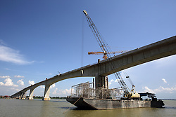 The new bridge being constructed over the Mekong River in near Stung Treng town. Stung Treng Province, Cambodia.