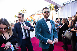 Scott Evans and Chris Evans arrive on the red carpet of The 91st Oscars® at the Dolby® Theatre in Hollywood, CA on Sunday, February 24, 2019.