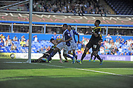 Birmingham City's Jesse Lingard (c) slides in to score his side's 1st goal during the Skybet championship match, Birmingham city v Sheffield Wednesday at St.Andrews in Birmingham, England on Sat 21st Sept 2013. pic by Jeff Thomas/Andrew Orchard sports photography