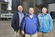 SHOT 10/29/18 9:47:48 AM - Sunrise Cooperative is a leading agricultural and energy cooperative based in Fremont, Ohio with members spanning from the Ohio River to Lake Erie. Sunrise is 100-percent farmer-owned and was formed through the merger of Trupointe Cooperative and Sunrise Cooperative on September 1, 2016. Photographed at the Clyde, Ohio grain elevator was George D. Secor President / CEO and John Lowry<br /> Chairman of the Board of Directors with  CoBank RM Gary Weidenborner. (Photo by Marc Piscotty © 2018)