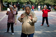 Pensioners practicing Thai Chi during an early morning in a park close to the city center of Beijing. Beijing is the capital of the People's Republic of China and one of the most populous cities in the world with a population of 19,612,368 as of 2010.