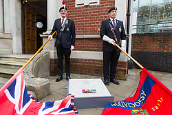 Two veteran flag bearers pose with their flags and the memorial stone as The London Borough of Haringey and representatives of the Armed Forces honour Lieutenant-Colonel Sir Brett Mackay Cloutman VC MC KC with the unveiling of the final London Victoria Cross Commemorative paving stone in Hornsey, London. November 06 2018.