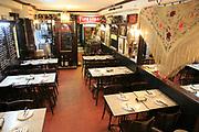 Restaurant dining tables inside famous historic Los Gatos Cervecerias bar, Madrid, Spain