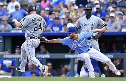 July 23, 2017 - Kansas City, MO, USA - Kansas City Royals first baseman Eric Hosmer reaches back to tag out Chicago White Sox's Matt Davidson on a wide throw from shortstop Alcides Escobar in the fourth inning on Sunday, July 23, 2017 at Kauffman Stadium in Kansas City, Mo. (Credit Image: © John Sleezer/TNS via ZUMA Wire)
