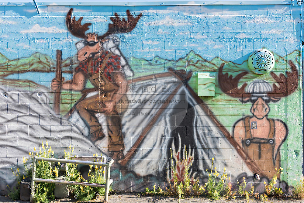 A painted wall mural of moose in downtown Anchorage, Alaska.