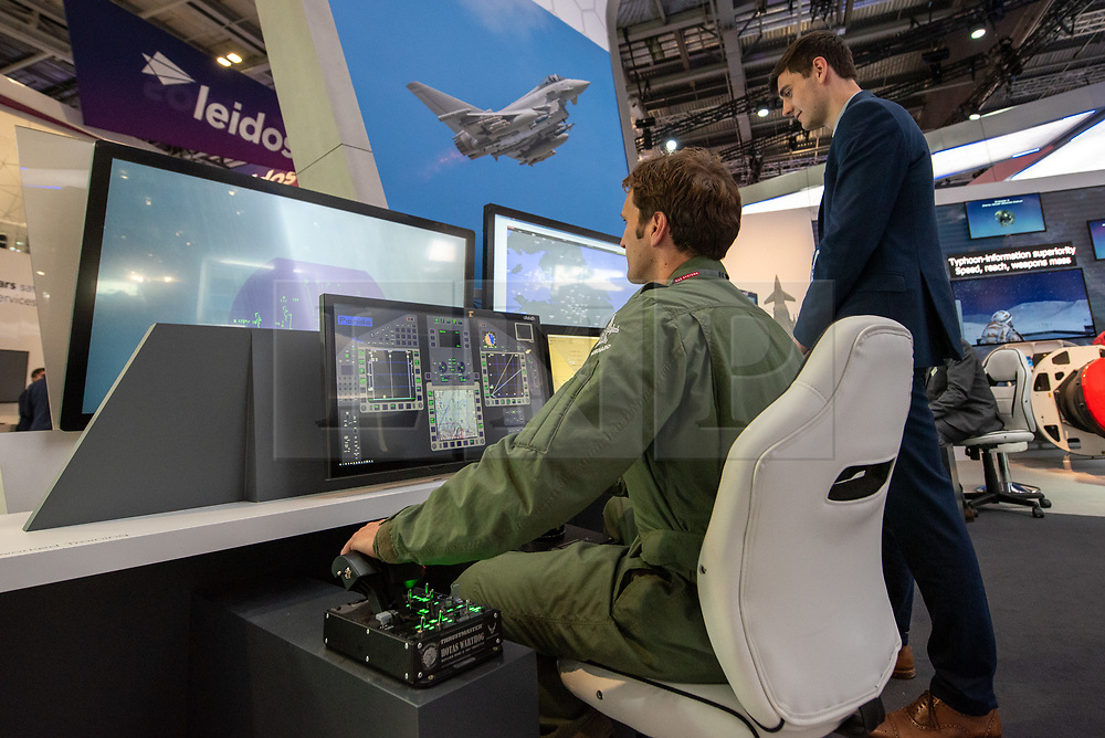 © Licensed to London News Pictures. 10/09/2019. London, UK. A pilot demonstrates a flight simulator at DESI. Defence & Security Equipment International (DESI) is the worlds largest arms fair and is held every two years in London. Photo credit: Peter Manning/LNP
