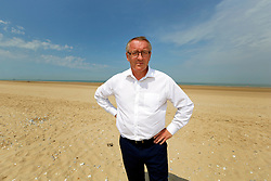 26 June 2020. Bleriot Plage, Calais, France.<br /> Andy lines, senior reporter for the Daily Mirror on Bleriot Plage, one of the many beaches close to the main ferry terminal in Calais where migrants often make desperate and dangerous attempts to cross one of the busiest shipping lanes in the world. Migrants are crossing the English Channel (La Manche) by boat, kayak, surf board and even inflatable paddling pools as numbers seeking asylum in the UK continue to rise. <br /> Photo©; Charlie Varley/varleypix.com