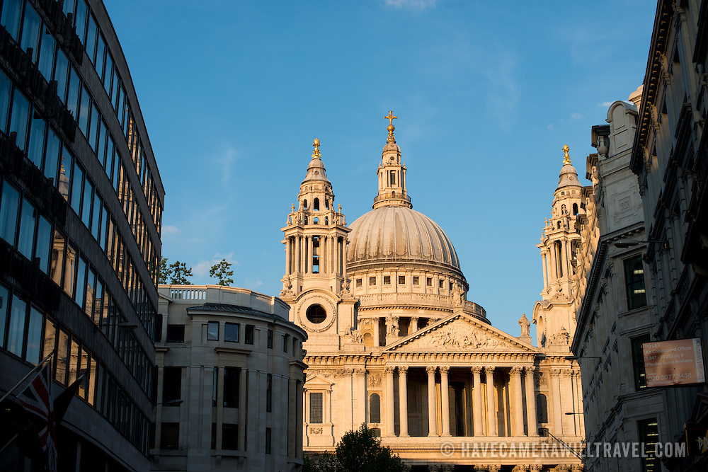 The late afternoon golden light catches the dome of St Paul's Cathedral, one of the most distinctive of London's landmarks. There has been a church on this site since 604 AD. The current building, with it's massive dome, was designed by Christopher Wren and dates back to the late 17th century.
