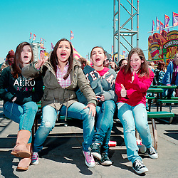Houston, Texas - March 2010- Teenage girls go crazy at the mention of Justin Bieber, the evening's entertainment, during a kids entertainment performance on the midway of the  Houston Rodeo.   Photo by Susana Raab