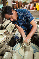 Ko Kret Potter - On Ko Kret island here are many artisans producing pottery . They are made by hand and follow the old traditional Mon style.  Mon people have always been skillful in pottery since their settlement in the delta of Irawadi River. Later, at the time of Mon?s installation to Thailand during the Thonburi era, pottery has become since then Nonthaburi?s oldest handicraft and symbol with the notably beautiful characteristic Mon design. Mon pottery, is known for its baked unglazed red clay carved with intricate patterns.