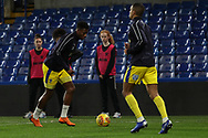 AFC Wimbledon defender Paul Kalambayi (30) warming up during the EFL Trophy match between U21 Chelsea and AFC Wimbledon at Stamford Bridge, London, England on 4 December 2018.