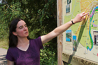 Mde. Pastor, Environmental Agent of the city of Pont-du-Chateau explaining sign-posted nature walks around the city. Pont-du-Chateau, Auvergne, France.