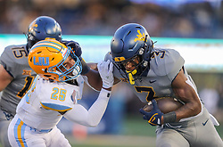 Sep 11, 2021; Morgantown, West Virginia, USA; West Virginia Mountaineers wide receiver Kaden Prather (3) runs after a catch and stiff arms Long Island Sharks defensive back Rudy Silvera (25) during the third quarter at Mountaineer Field at Milan Puskar Stadium. Mandatory Credit: Ben Queen-USA TODAY Sports