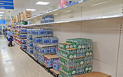 © Licensed to London News Pictures 23/07/2021. Sidcup, UK. Empty shelves in the water aisle at Sidcup Tesco in South East London. Shoppers continue to seeing a shortage of bottled water in supermarkets today as supplies have been hit by staff being forced to self-isolate. Photo credit:LNP