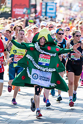 © Licensed to London News Pictures. 22/04/2018. London, UK. A man dressed as a Christmas tree attempts to break a world record during the Virgin Money London Marathon 2018. Photo credit: Rob Pinney/LNP