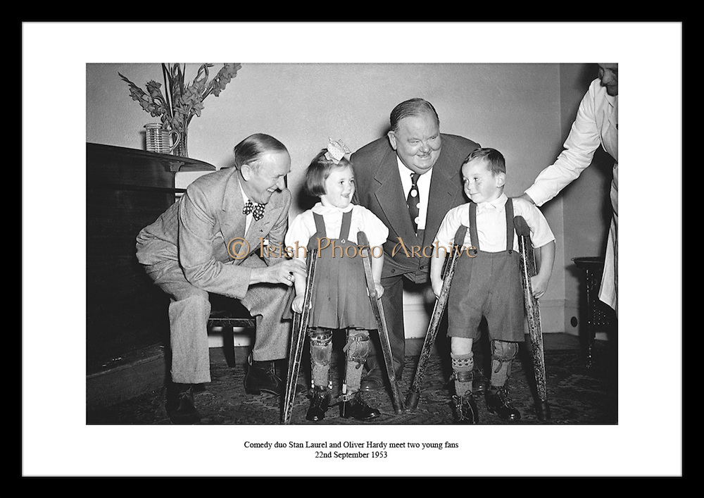 Comedy duo Stan Laurel and Oliver Hardy meet two young fans<br /> 22nd September 1953