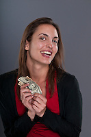 Young Caucasian woman happy after receiving some money