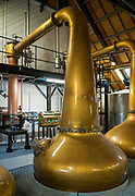 Copper pot whisky spirit still at Arran Whisky Distillery, one of the famous Scottish distilleries, at Lochranza, Isle of Arran, Scotland