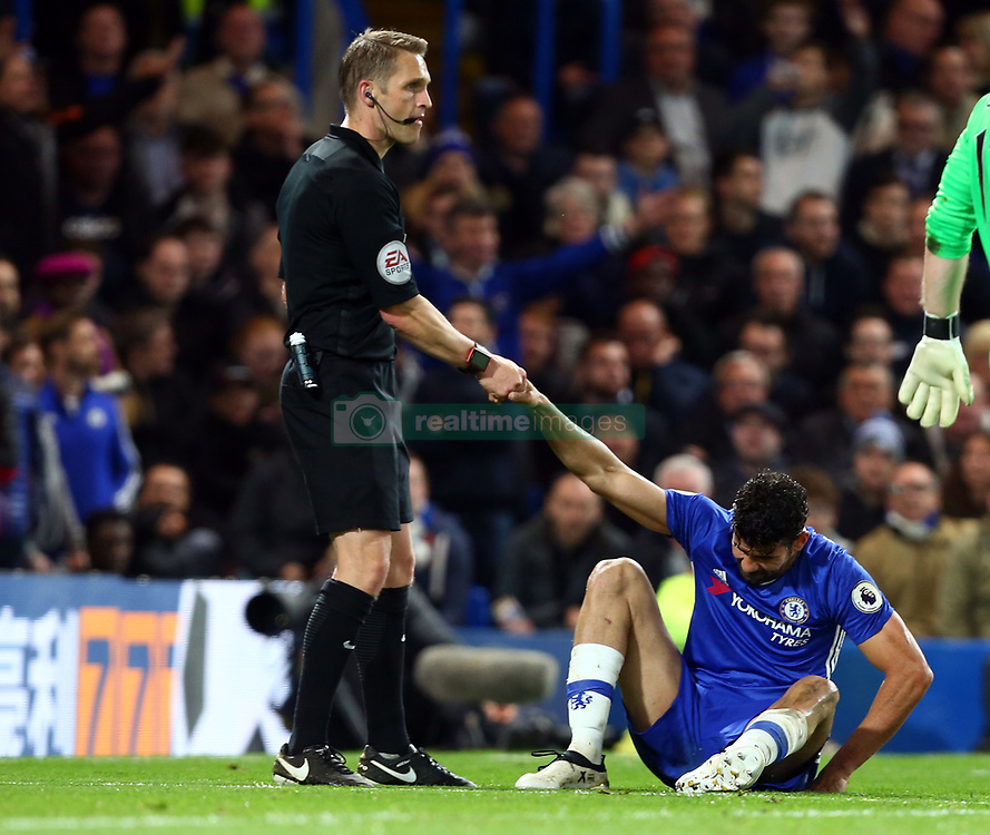 May 8, 2017 - Chelsea, Greater London, United Kingdom - Referee Craig Pawson gives a hand to Chelsea's Diego Costa.during Premier League match between Chelsea and Middlesbrough at Stamford Bridge, London, England on 08 May 2017. (Credit Image: © Kieran Galvin/NurPhoto via ZUMA Press)