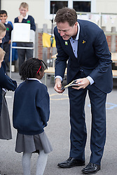 © Licensed to London News Pictures . 03/07/2014 . Leeds , UK . The Deputy Prime Minister , NICK CLEGG MP , at Ireland Wood Primary School in Leeds today (Thursday 3rd July 2014) receives a gift from students . The Liberal Democrat leader and MP for Sheffield Hallam watches a Grand Depart school event with children taking part in cycling time trials and singing the the Tour de France anthem . Photo credit : Joel Goodman/LNP
