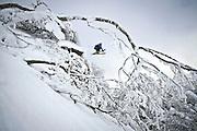 Antonio Tamayo jumping over a rock in the San Lorenzo Peak in Spain.