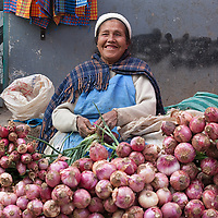 A woman selling onions at a market in Tarma.