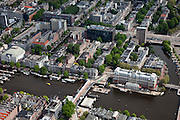 Nederland, Amsterdam, Centrum, 25-05-2010. Binnenstad met aan de Amstel het Amstelhotel en  Carre, rechts de Mauritskade.Overview of the city, the river Amstel..luchtfoto (toeslag), aerial photo (additional fee required).foto/photo Siebe Swart