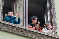 Coronavirus - Flash mob, from the windows and balconies of the houses, the Milanese face and applaud for a long time to the doctors, nurses and all those who are facing the health emergency at the forefront. Milan, Italy on March 14, 2020. Photo by Marco Passaro/IPA/ABACAPRESS.COM