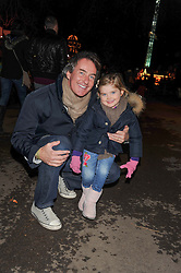 TIM JEFFERIES and his daughter COCO at the opening of the 2012 Winter Wonderland, Hyde Park on 22nd November 2012.