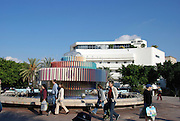 Israel Tel Aviv The Yaacov Agam fountain at Zina Dizengoff circle at the intersection of Dizengoff, Pinsker Zamanhoff and Rienes streets in the centre of the city. The Bauhaus building of the cinema hotel can be seen in the background