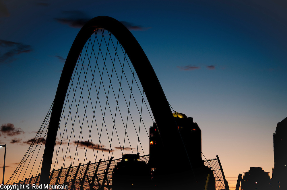 The silhouette of Griffiths Drive Pedestrian Overpass at Dusk. Burnaby, British Columbia