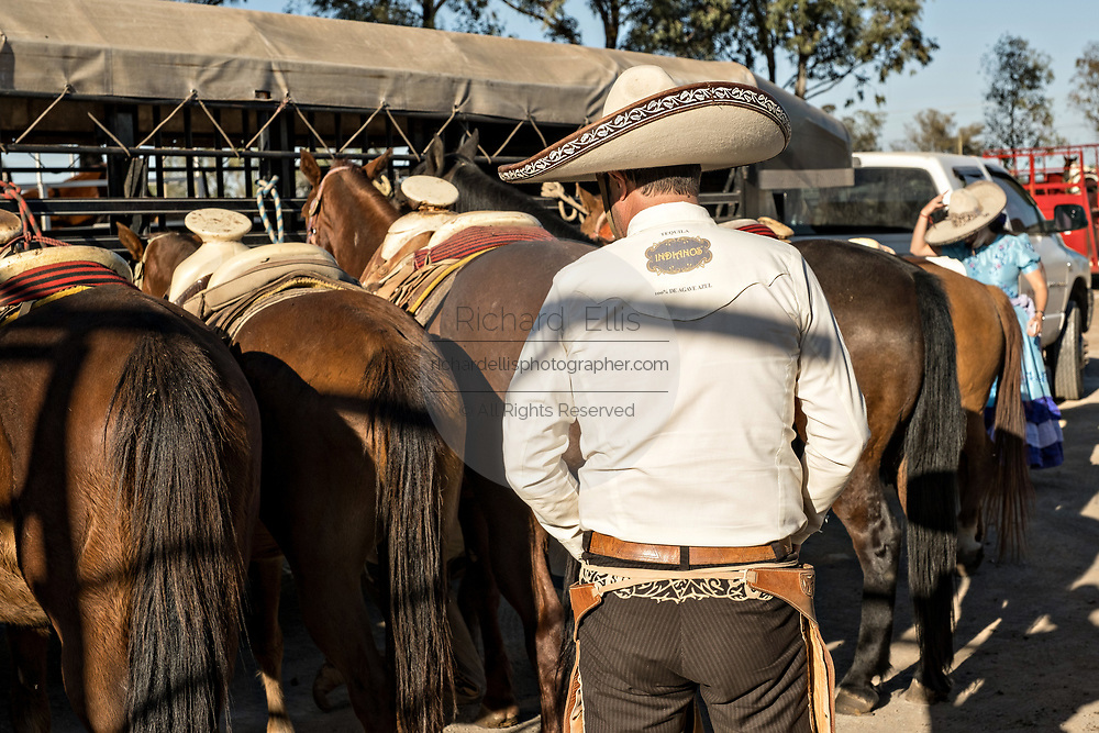 Juan Franco, Sr., dresses in the traditional Charro costume as he readies for a family practice session in the Jalisco Highlands town of Capilla de Guadalupe, Mexico. The Franco family has dominated Mexican rodeo for 40-years and has won three national championships, five second places and five third places.