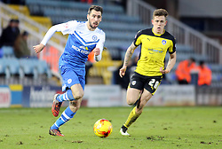 Peterborough United's Michael Smith is tracked by Colchester United's Sammie Szmodics - Photo mandatory by-line: Joe Dent/JMP - Mobile: 07966 386802 - 10/01/2015 - SPORT - Football - Peterborough - ABAX Stadium - Peterborough United v Colchester United - Sky Bet League One