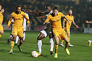 John Akinde of Barnet © is challenged by Mark Randall of Newport county ®.EFL Skybet football league two match, Newport county v Barnet at Rodney Parade in Newport, South Wales on Tuesday 25th October 2016.<br /> pic by Andrew Orchard, Andrew Orchard sports photography.