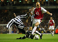 Photograph: Scott Heavey.<br />Arsenal v Newcastle United. FA Barclaycard Premiership. 26/09.2003.<br />Titus Bramble with a strong challenge on Pascal Cygan