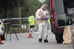 © Licensed to London News Pictures. 01/07/2017. GRAYS, Essex, UK.  A forensic officer working within the police cordon at Blackshots Lane in Grays, Essex. A man has died and three others have life threatening injuries following a street fight in Blackshots Lane, Grays, Essex last night.  Photo credit: Vickie Flores/LNP