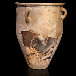 The Minoan clay burial pithos with skeleton in foetal,  Neopalatial period 1700-1450 BC; Heraklion Archaeological  Museum, black background<br /> <br /> The body was placed in a foetal postion to aid insertion into the wide mouthed pithos