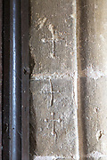 Crucifix cross symbols  carved into stone of doorway entrance to the historic village parish church Marden, Wiltshire, England, UK - reputedly marks left by those going off to the Crusades to be completed on safe return