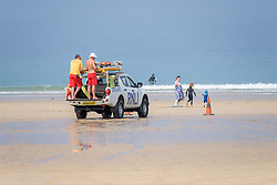 RNLI Lifeguaqrds on duty at Fistral Beach in Newquay, Cornwall.