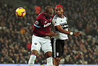 Football - 2018 / 2019 Premier League - West Ham United vs. Fulham<br /> <br /> Ryan Babel of Fulham out jumps Angelo Ogbonna of West ham at The London Stadium.<br /> <br /> COLORSPORT/ANDREW COWIE