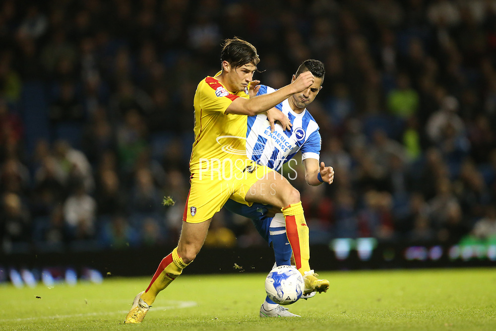 Rotherham United midfielder Joe Newell beats Brighton central midfielder, Beram Kayal during the Sky Bet Championship match between Brighton and Hove Albion and Rotherham United at the American Express Community Stadium, Brighton and Hove, England on 15 September 2015.
