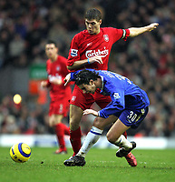 Photo:Ryan Browne/Back Page Images.<br />Liverpool v Chelsea, FA Barclays Premiership, Anfield, 01/01/05<br />Chelseas Tiago right goes down from a challenge made by Steven Gerrard